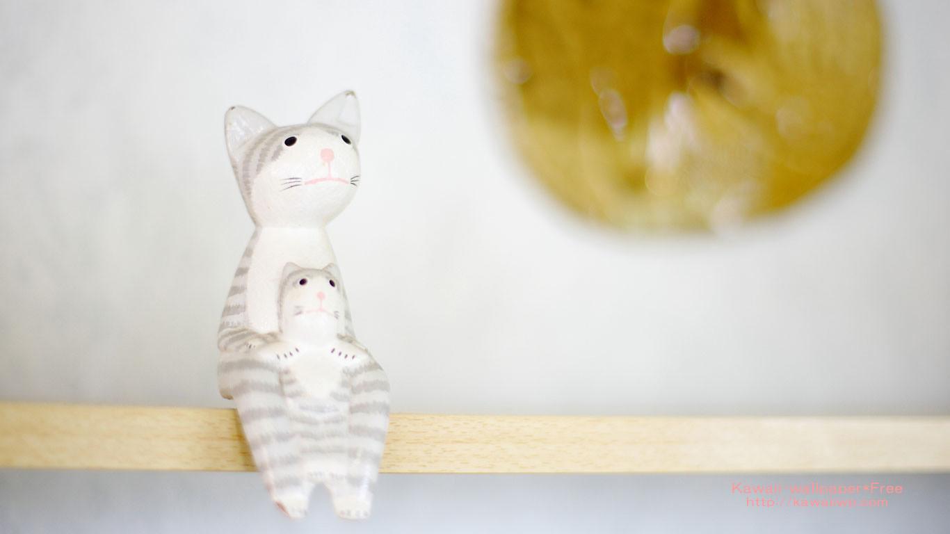 かわいい猫の親子が腰かける壁紙